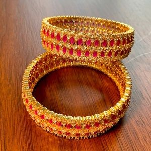 2 gold, silver and pink stone bangles